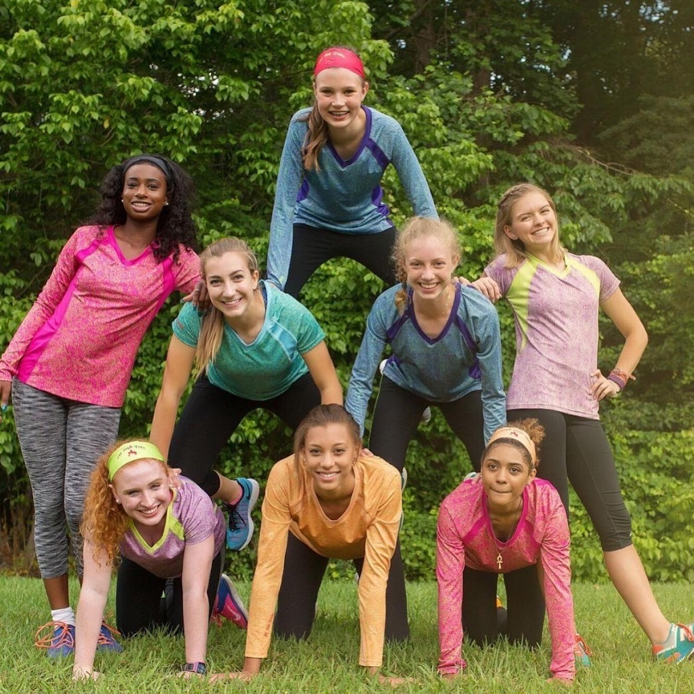 Sparkfire Image Nailed It Young Women in a pyramid with Athletic clothes