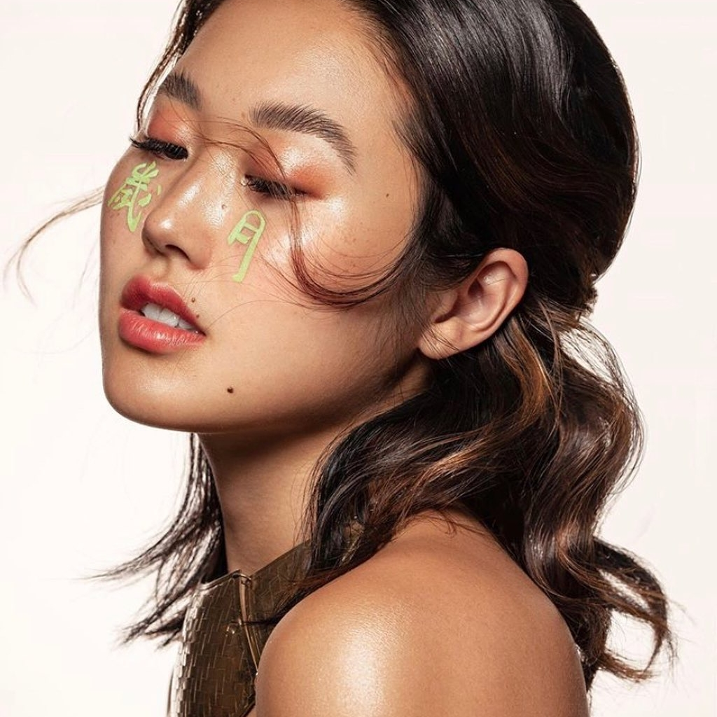 Touch in Sol Image Nailed It Young Woman with symbols on face in green