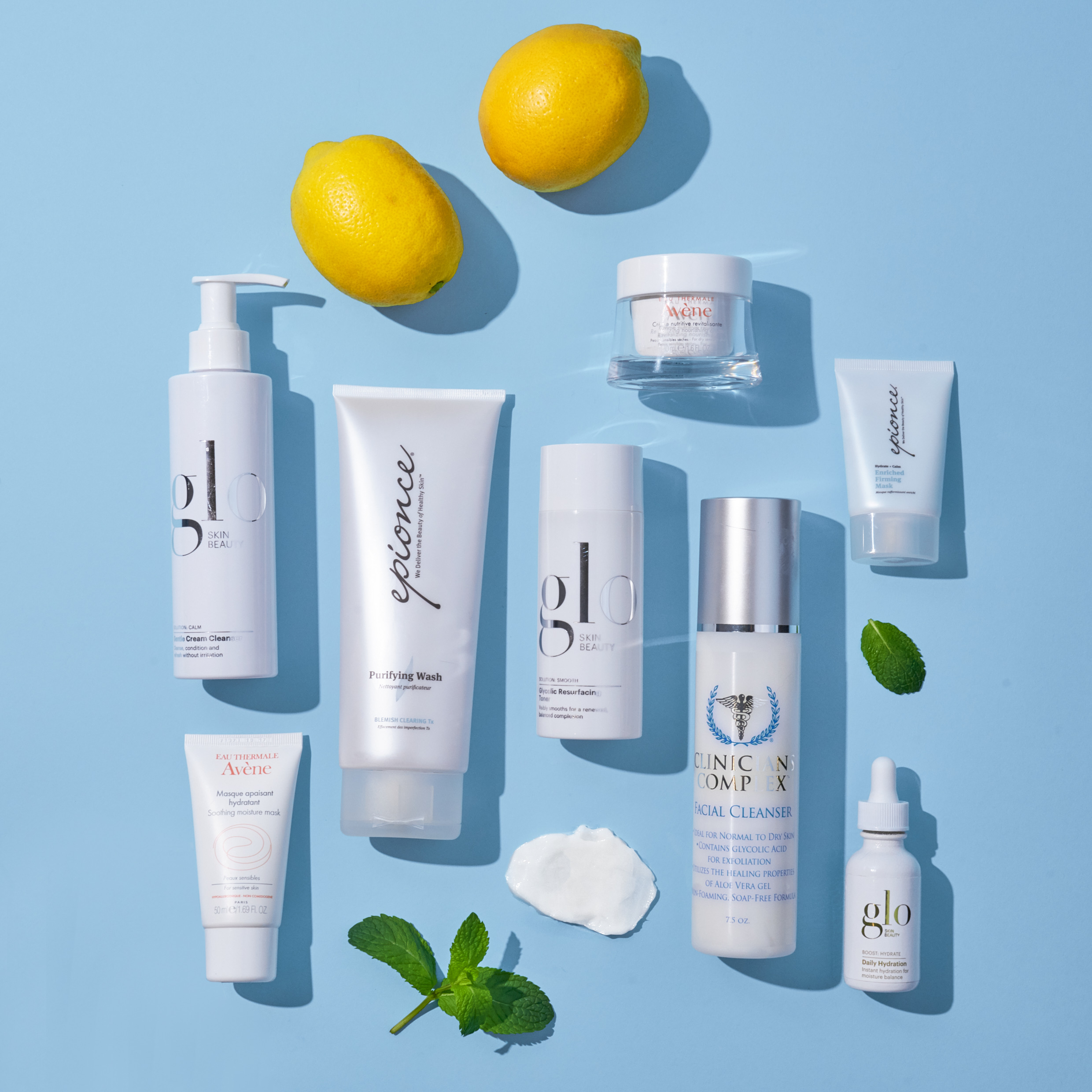 Image Nailed It skincare arranged on blue backdrop with lemons