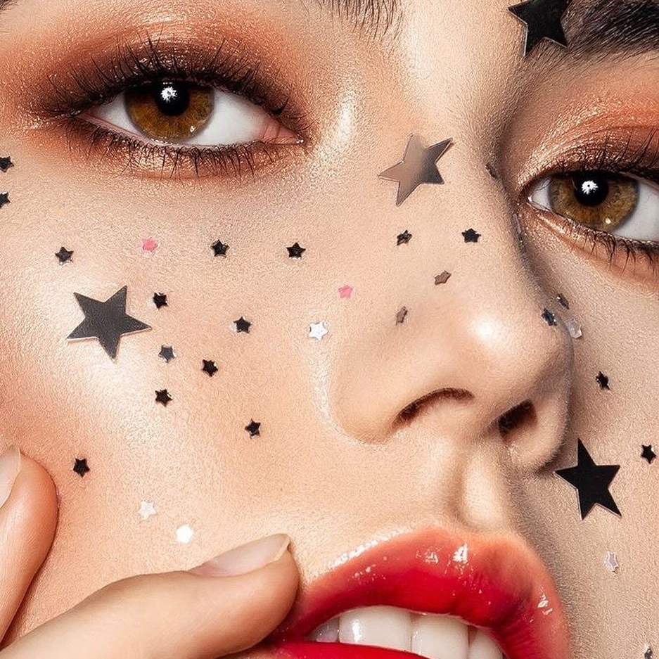 Touch in Sol Image Nailed It Close up of woman with stars on her face