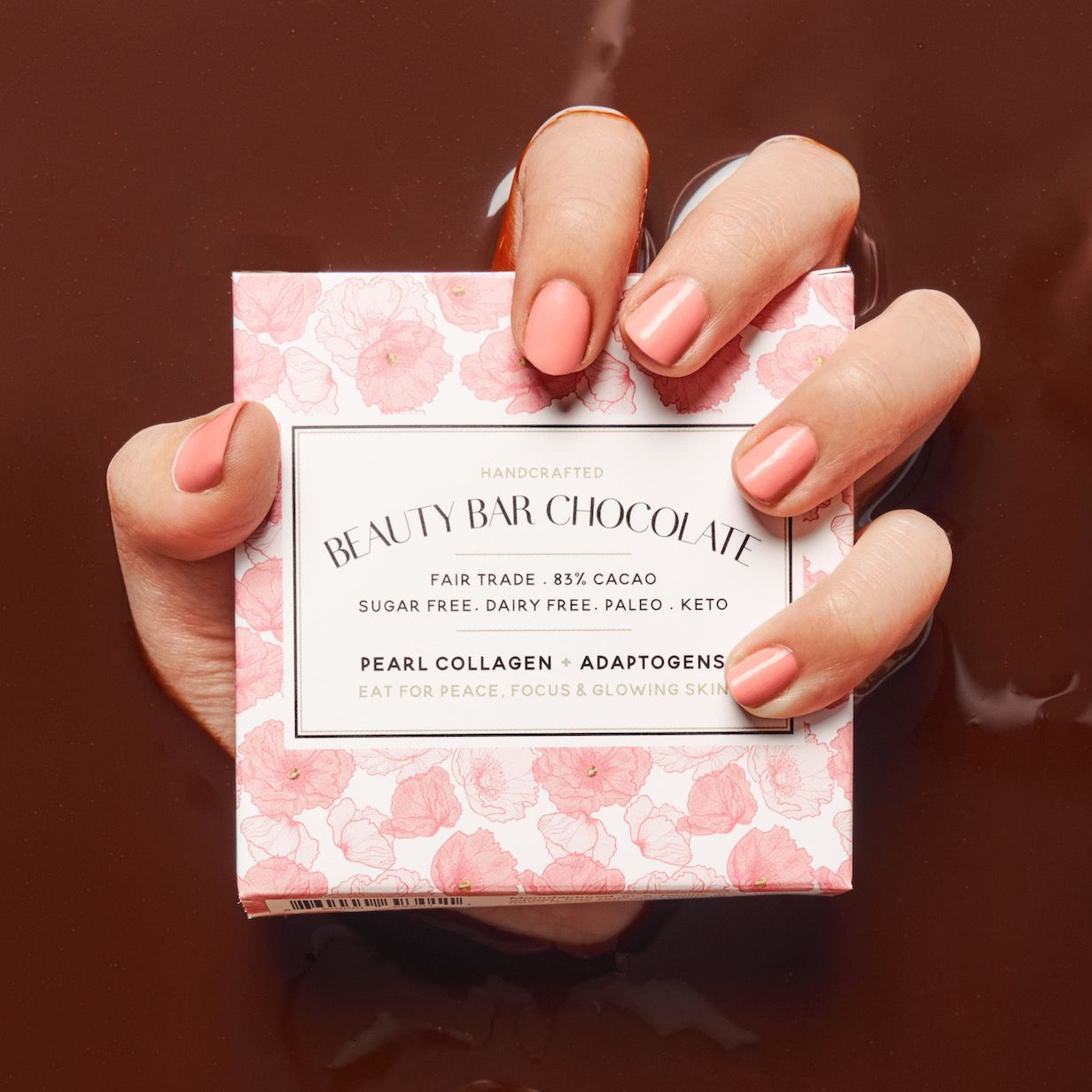 Beauty Bar Chocolate Image Nailed It Hand Holding Chocolate pink box coming through a chocolate backdrop