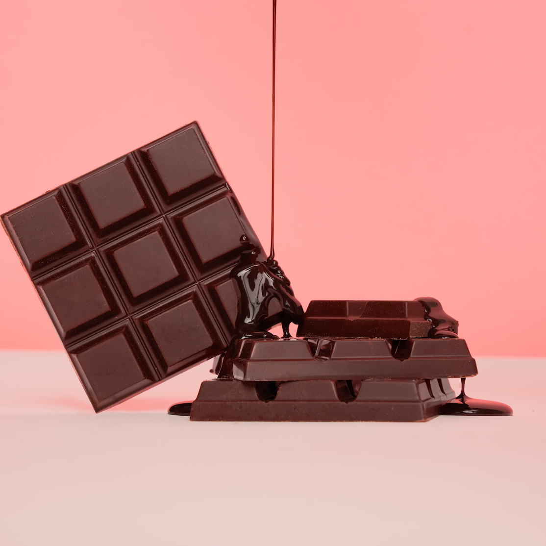 Beauty Bar Chocolate Image Nailed It Chocolate Pouring over Chocolate on Pink Backdrop