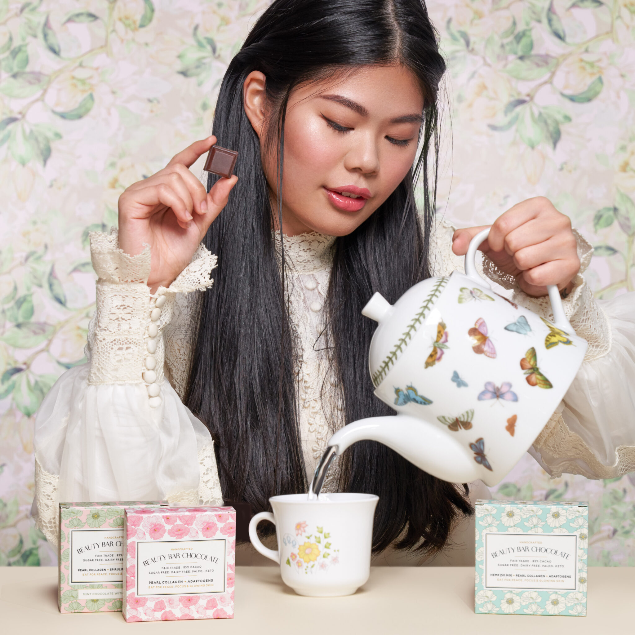 Beauty Bar Chocolate Image Nailed It Women pouring tea with chocolate boxes and flower backdrop