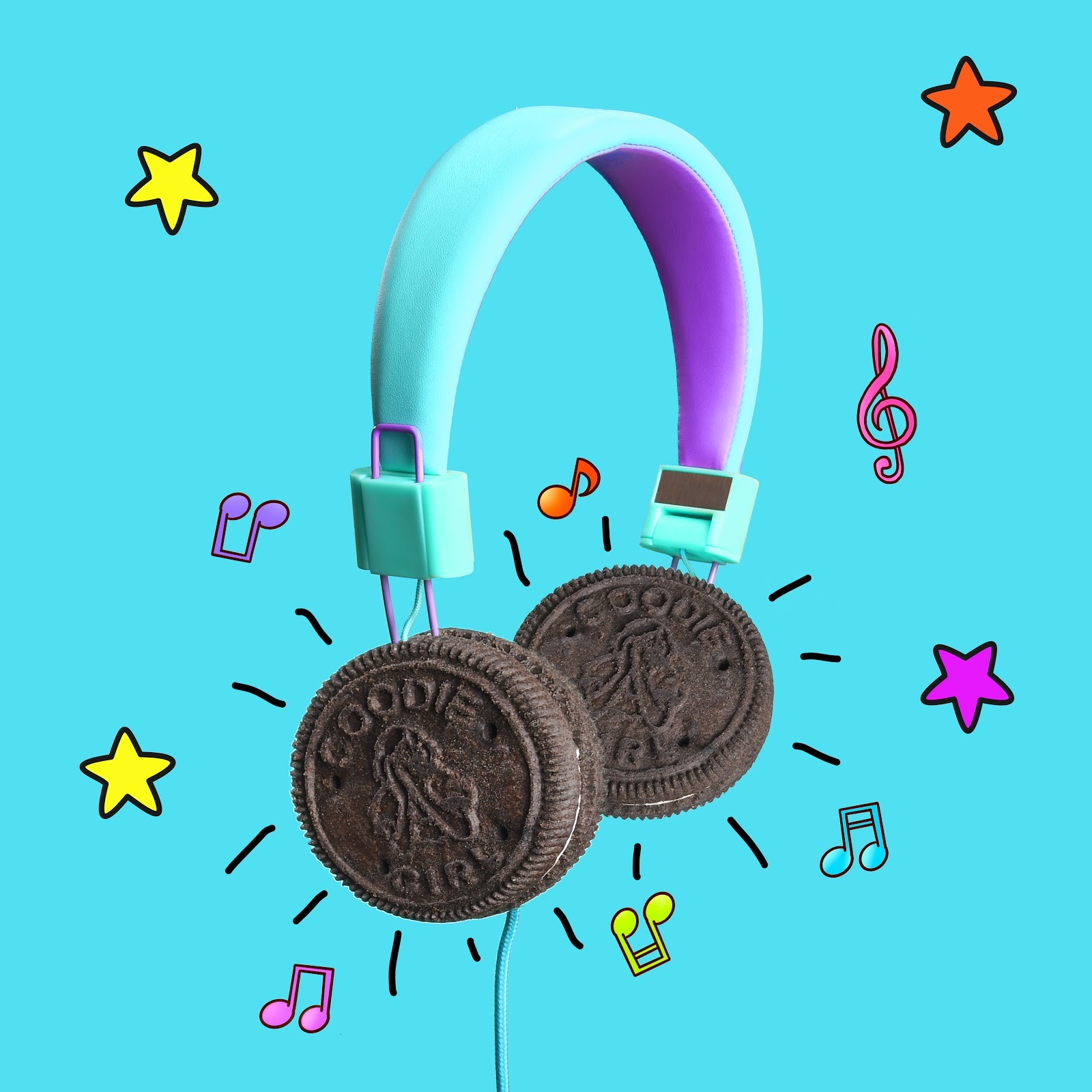 Goodie GIrl Cookies as headphones on blue backdrop