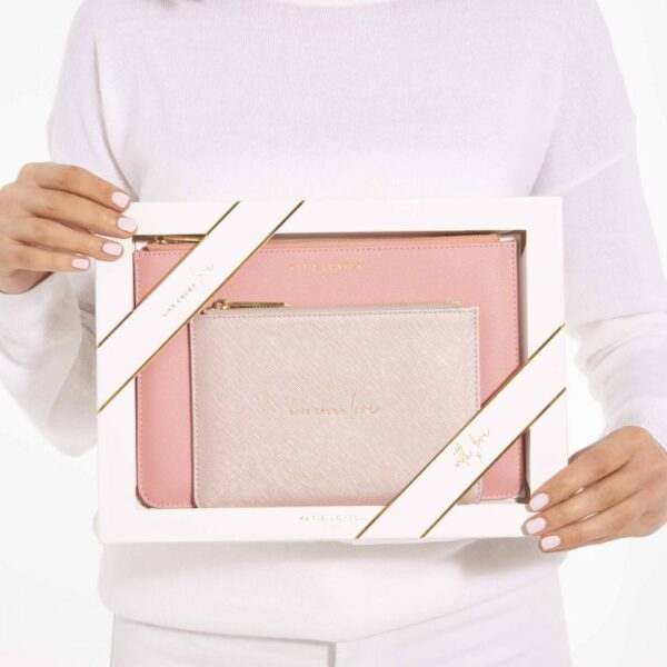 Katie Loxton Perfect Pouch Gift Set Live Laugh Love Oyster Pink held by model