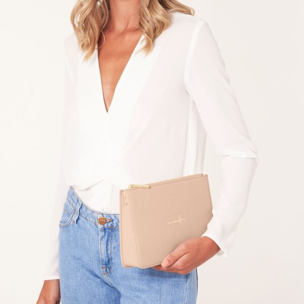 Katie Loxton Blush Pink Structured Pouch - Live Laugh Love - on model