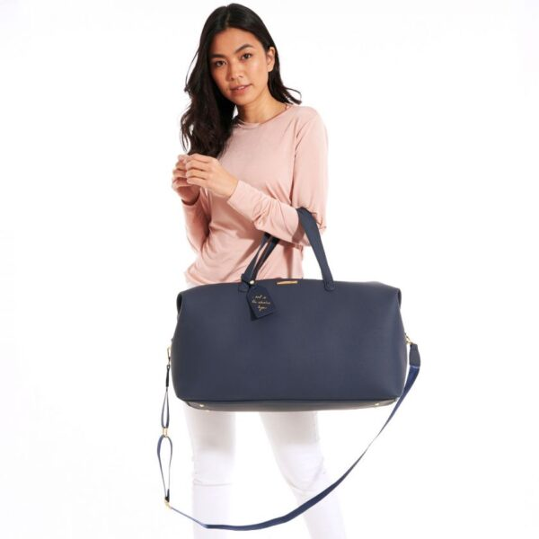 Katie Loxton Weekend Holdall Duffle Bag in Navy in Use 4
