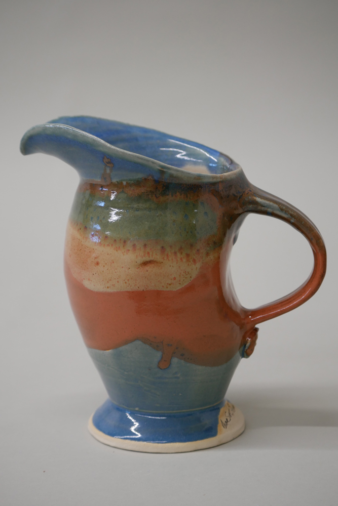 """<p style=""""font-size: 16px; line-height: 150%;""""><strong>Stoneware Aracari Pitcher</strong></p>"""
