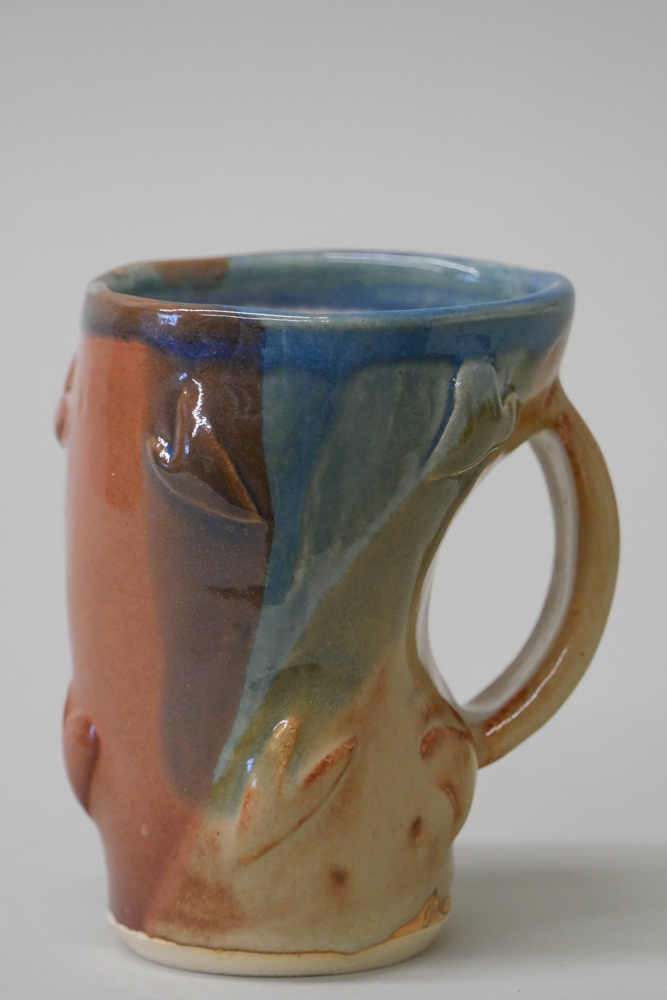 """<p style=""""font-size: 16px; line-height: 150%;""""><strong>Stoneware Altered Mug</strong></p>"""