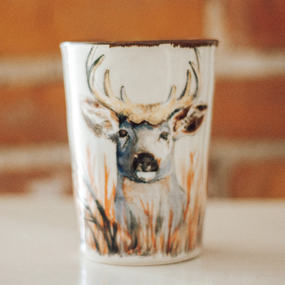 """<p style=""""font-size: 16px; line-height: 150%;""""><strong>Buck in the Brush Tumbler&emsp;</strong><br /> 12 oz.<br> <strong>$85</strong></p>"""