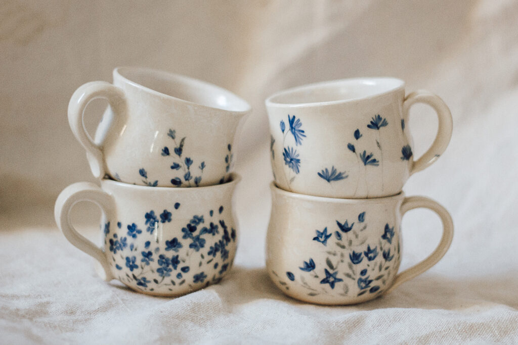 """<p style=""""font-size: 16px; line-height: 150%;""""><strong>Cottage Flowers in Blue</strong>&emsp;<br /> set of 4 teacups, 6 oz. each<br /> <strong>$130</strong></p>"""