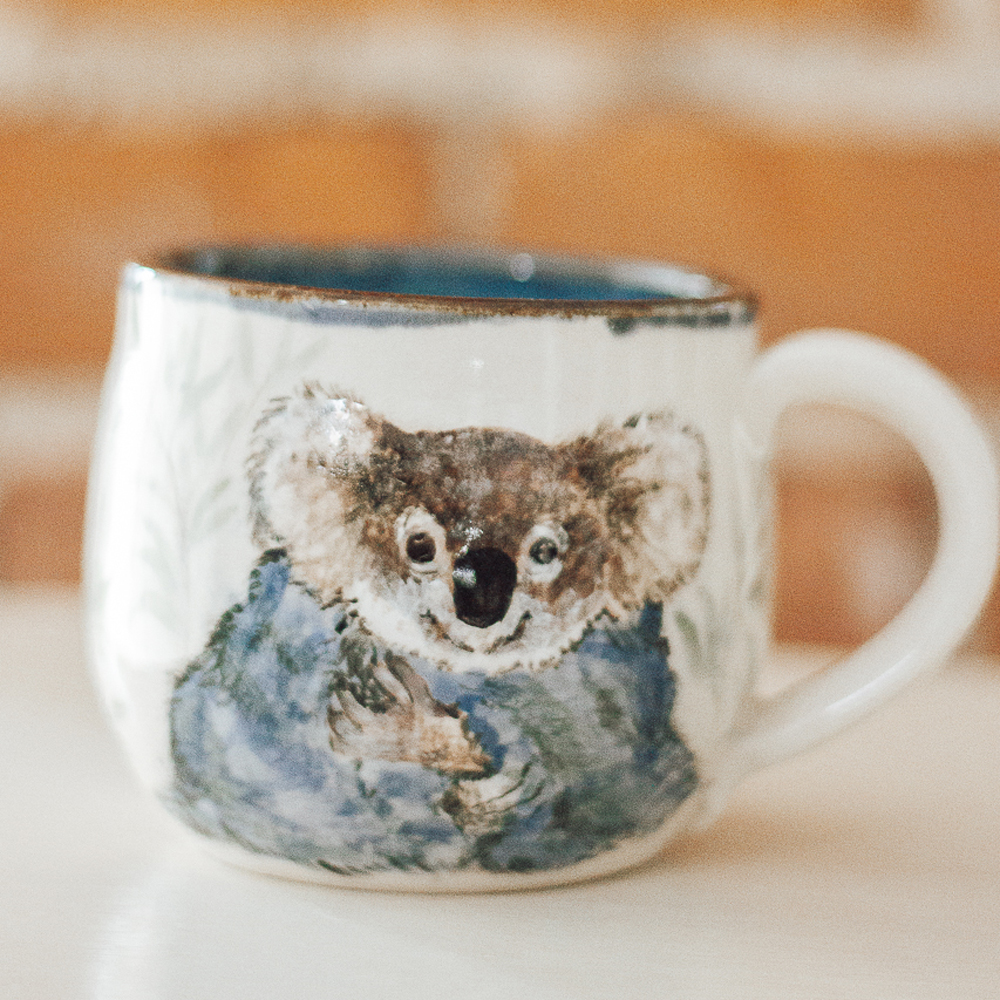 """<p style=""""font-size: 16px; line-height: 150%;""""><strong>Cozy Koala</strong>&emsp;<br />   12 oz.<br /> <strong>$75</strong></p>"""