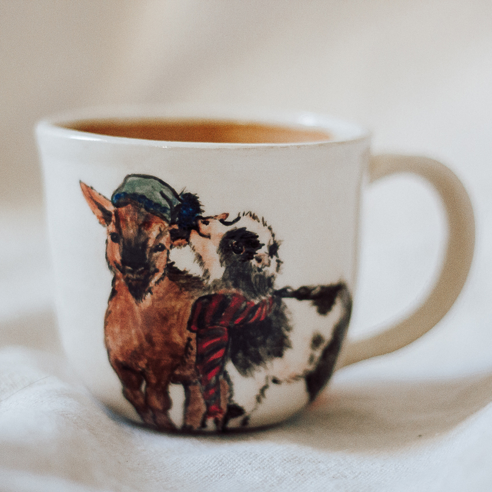 """<p style=""""font-size: 16px; line-height: 150%;""""><strong>Goat Pals Mug</strong>&emsp;<br /> 12 oz.<br> <strong>$65</strong></p>"""