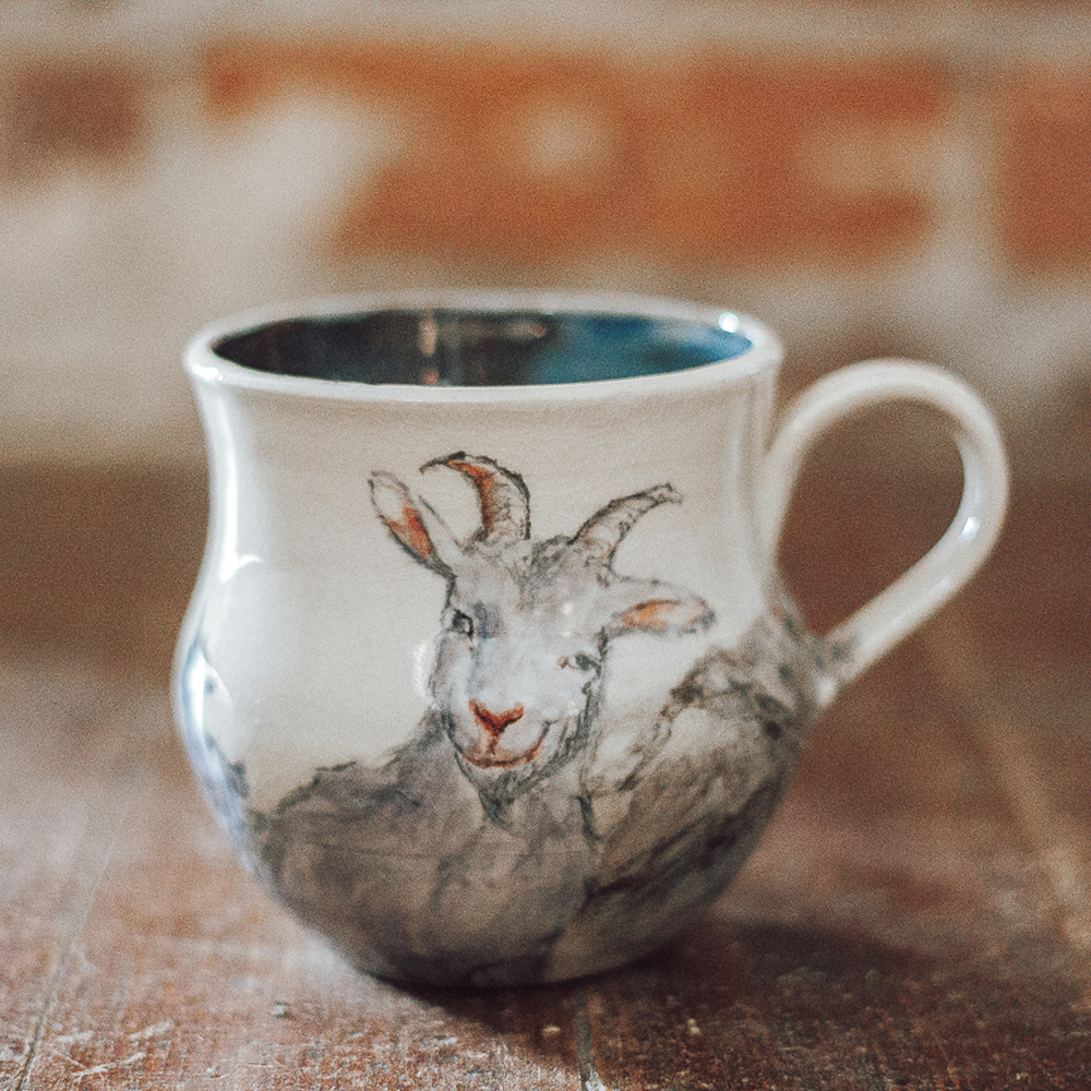 "<p style=""font-size: 16px; line-height: 150%;""><strong>Mountain Goats Mug</strong>&emsp;<br /> 12 oz.<br> <strong>$65</strong></p>"