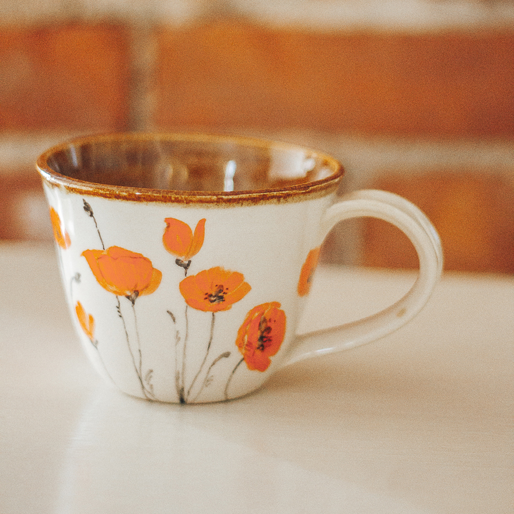 """<p style=""""font-size: 16px; line-height: 150%;""""><strong>Orange Poppies Mug</strong>&emsp;<br />   10 oz.<br /> <strong>$70</strong></p>"""