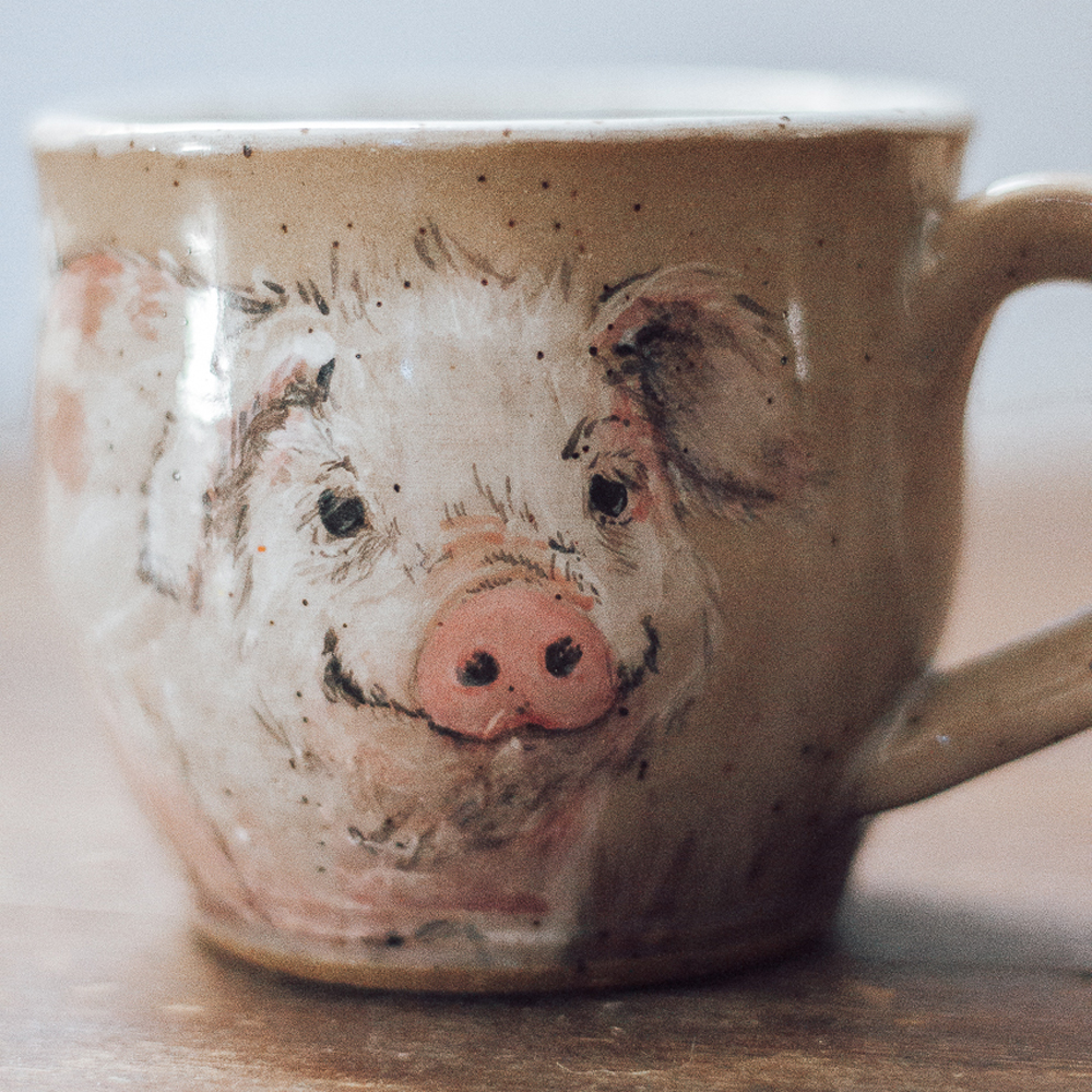 """<p style=""""font-size: 16px; line-height: 150%;""""><strong>Pig Mug&emsp;</strong><br /> 10 oz.<br /> <strong>$70</strong></p>"""
