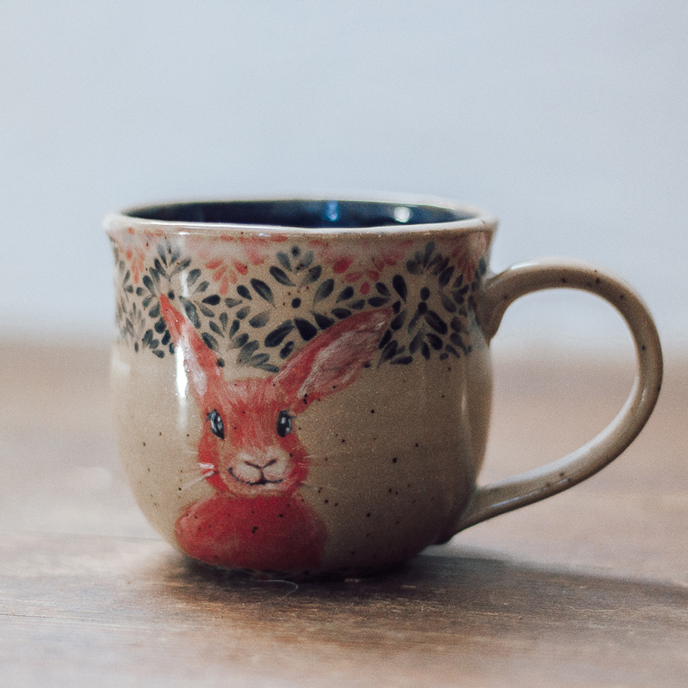 """<p style=""""font-size: 16px; line-height: 150%;""""><strong>Red Bunny Mug&emsp;</strong><br /> 12 oz.<br />  <strong>$70</strong></p>"""