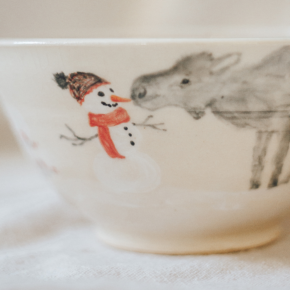"""<p style=""""font-size: 16px; line-height: 150%;""""><strong>Two Moose Meet a Snowman</strong>&emsp;<br /> small serving bowl 4&frac34;&rdquo; tall x 7&rdquo; wide<br /> <strong>$60</strong></p>"""