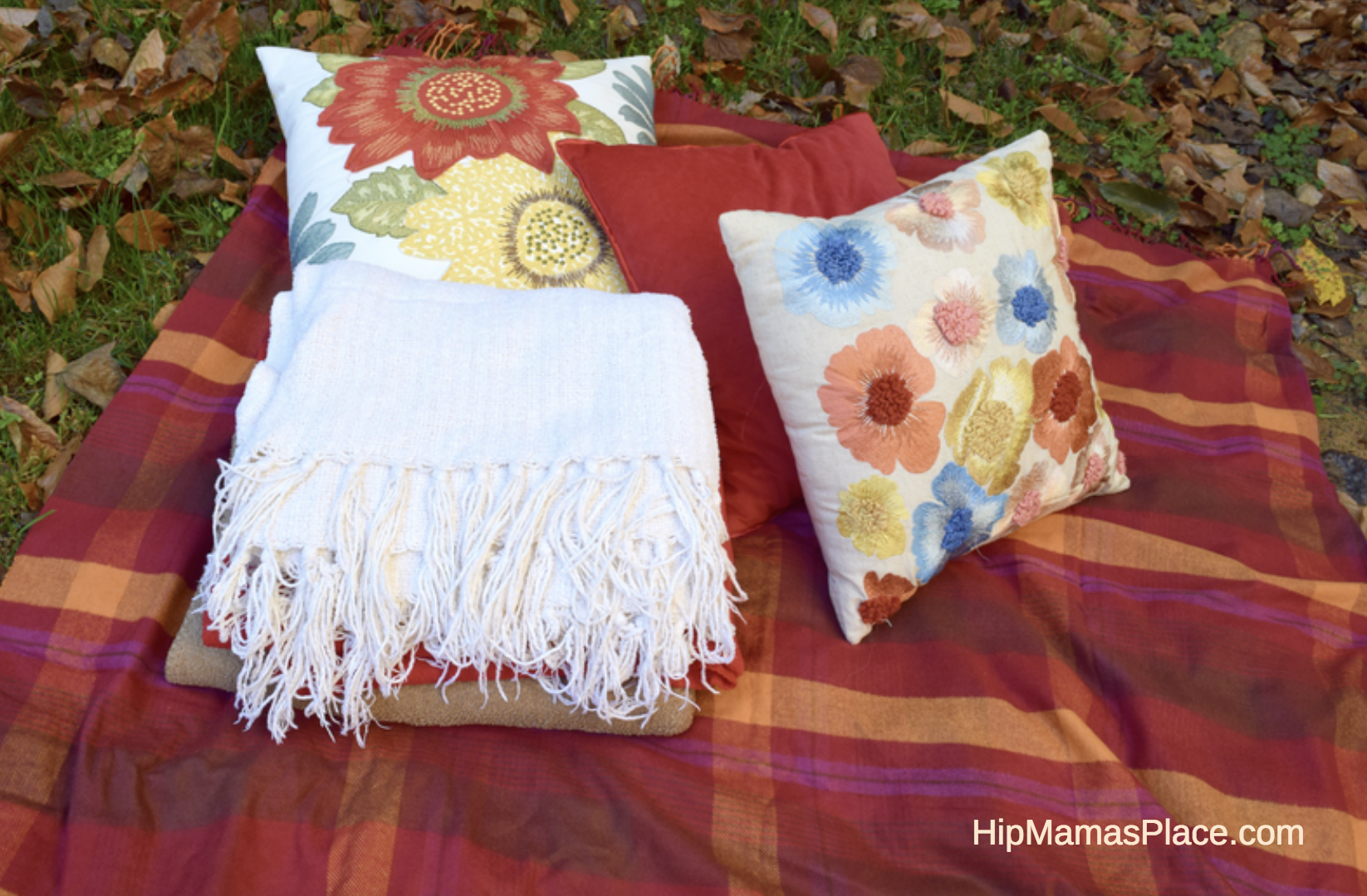 For a successful and fun fall picnic, toss blankets and floor pillows on the ground to create nesting spots.