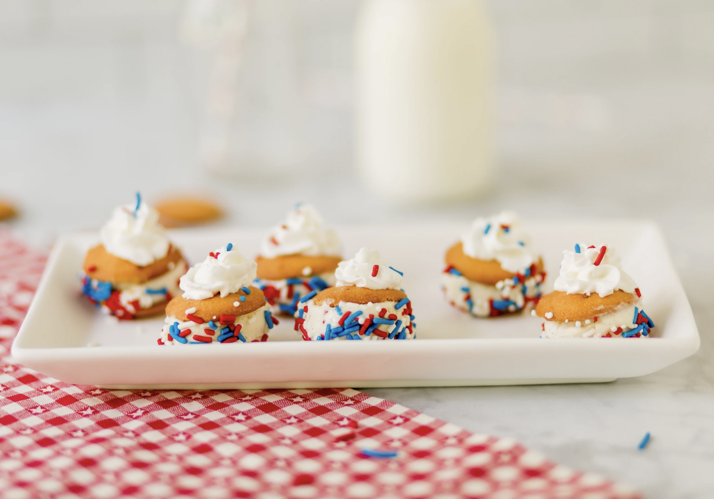 Patriotic, delicious and refreshing, these Red, White and Blue Mini Ice Cream Sandwiches with NILLA Wafers are the perfect summer snacks or desserts for your next summer party!