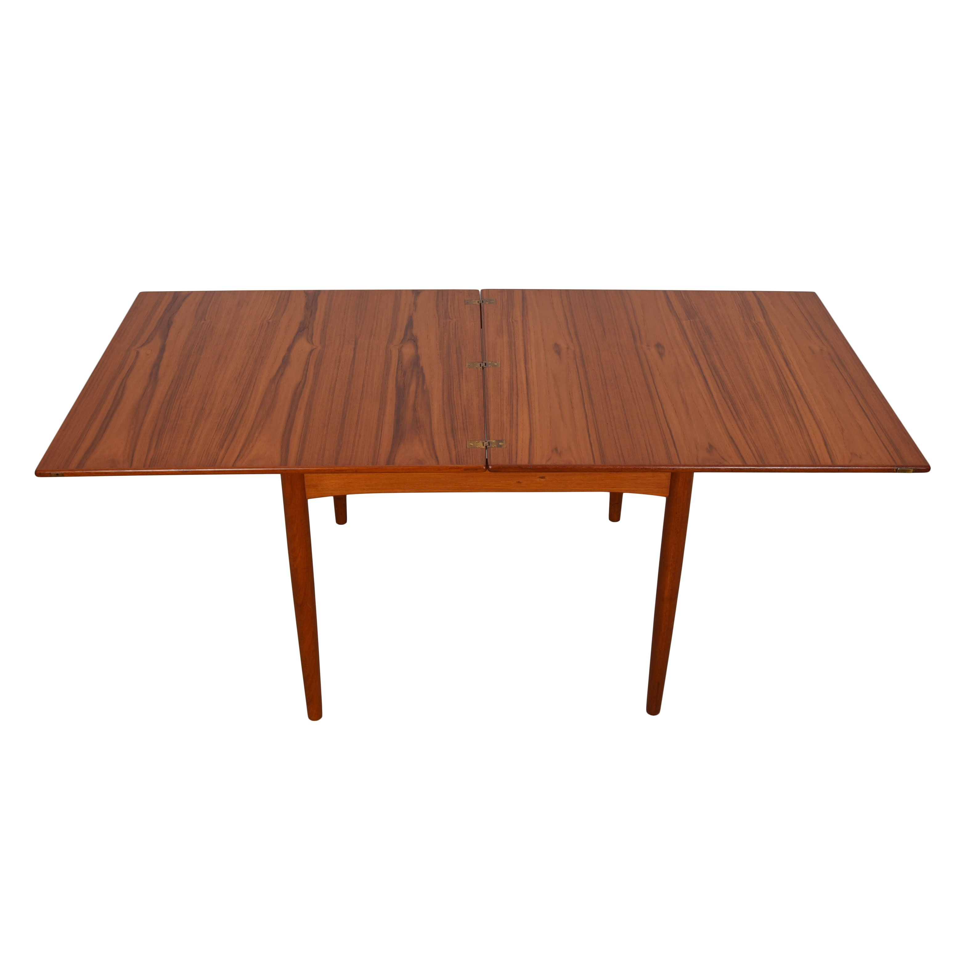 Square-to-Rectangle (35.5″ – 71″) Danish Teak Compact Expanding Dining Table.
