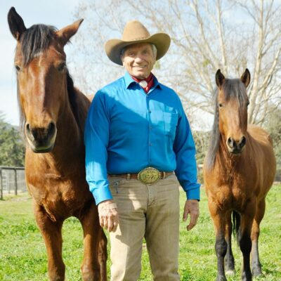 Monty Roberts at Flag Is Up Farms, Solvang, California, with Mustangs, Chief and Beauty - photo credit James Oliver