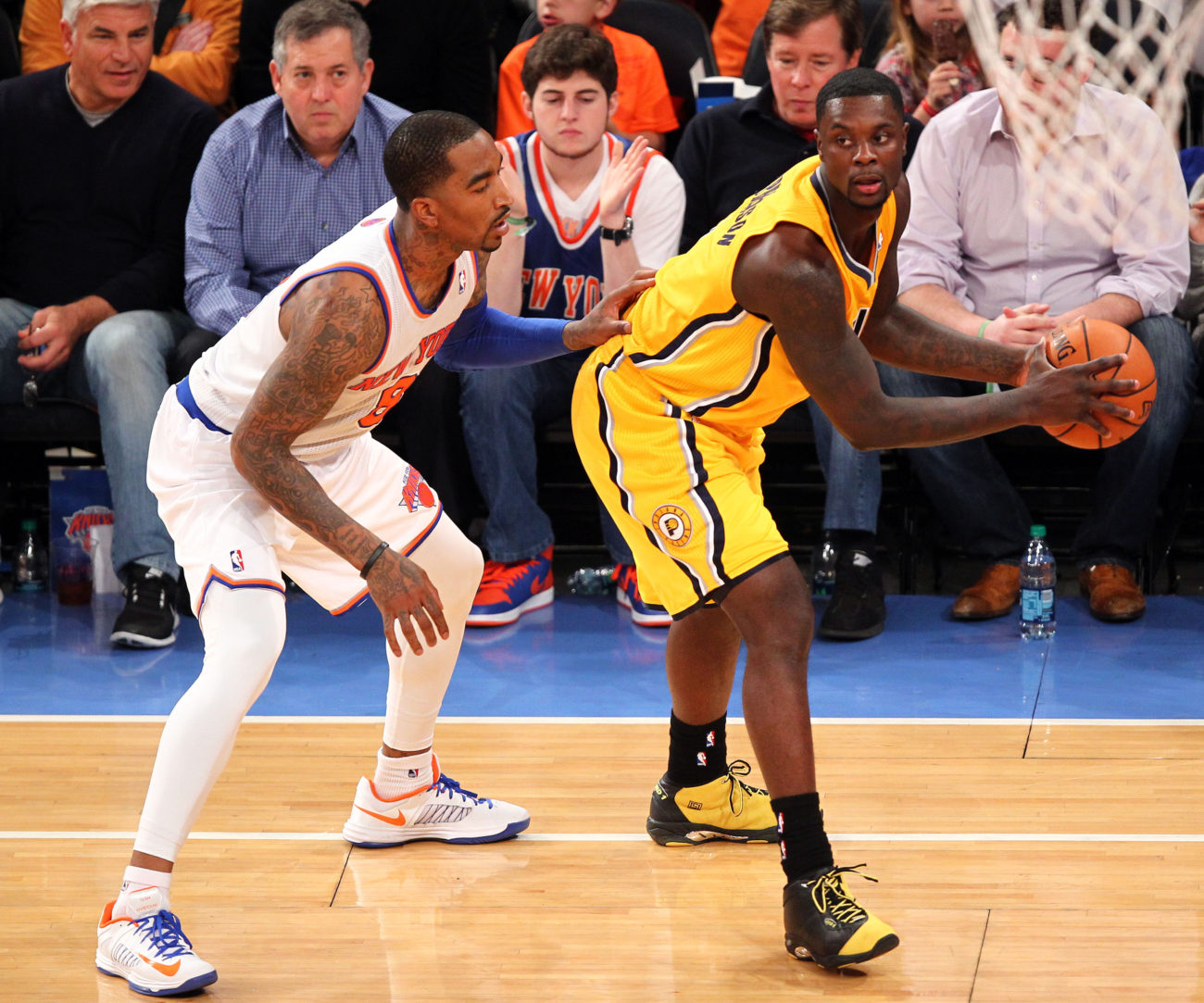 May 5, 2013; New York, NY, USA; New York Knicks guard J.R. Smith (8) guards Indiana Pacers guard Lance Stephenson (1) at Madison Square Garden. Mandatory Credit: Danny Wild-USA TODAY Sports