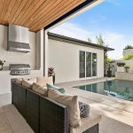 Patio and outdoor living area with pool by by Blue Daze Designs, orlando interior design