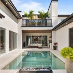 Balcony and courtyard with pool by Blue Daze Designs, orlando interior design