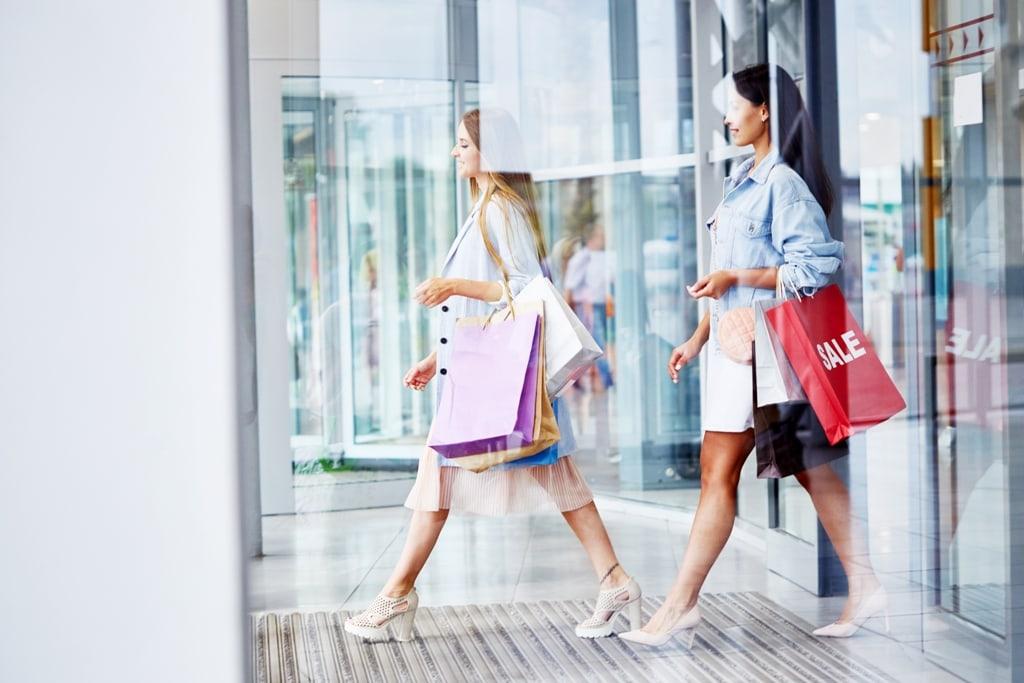 2 Women Shopping For Discounts