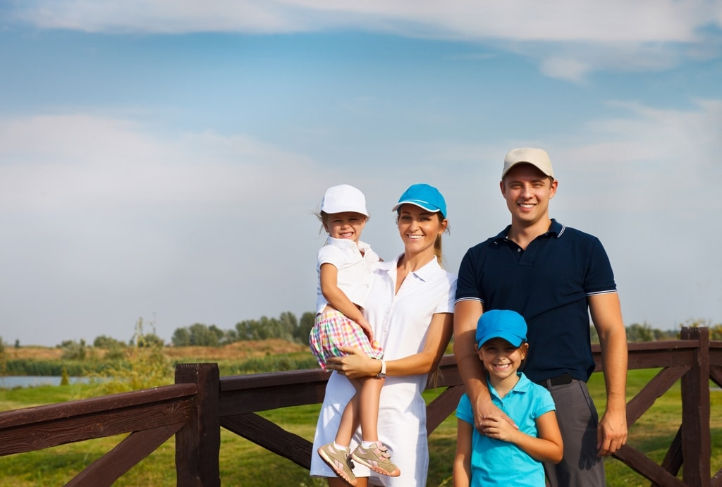 Family of 4 ready to Golf