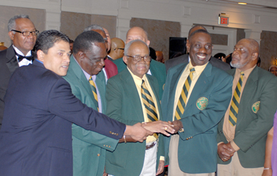 Andrew Headley (center) showing off his Cricket Hall of Fame induction ring in 2012. Photo by Shiek Mohamed