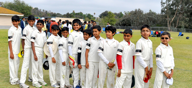 California Cricket Academy Boys with black ribbons showing respect for coach Owen Graham.