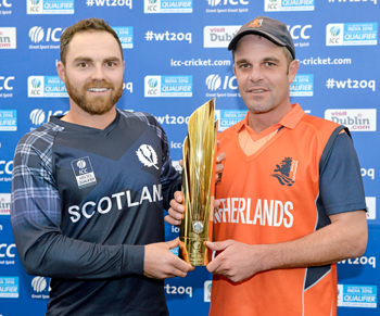 Team captains Preston Mommsen of Scotland (left), and Peter Borren of Netherlands, share the trophy after the Final was abandoned due to rain before a ball was bowled. Picture credit: Brendan Moran / ICC / SPORTSFILE