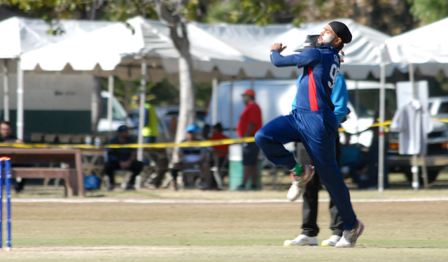 Jessy Singh bowls during the final of the ICC World Cricket League Division 4 against Oman. Photo by Shiek Mohamed