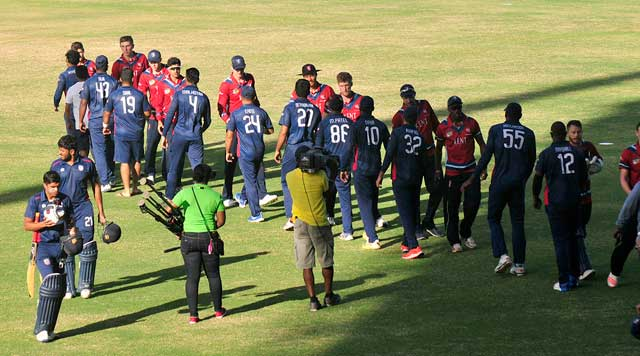 Players greet each other at conclusion of match.