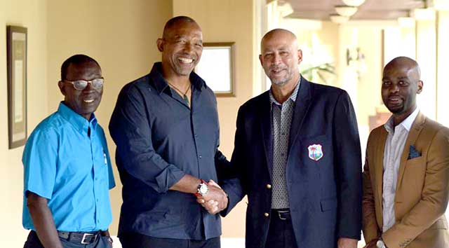 Pictured left to right, Director Enoch Lewis, Phil Simmons, President Ricky Skerritt and Vice-President Kishore Shallow