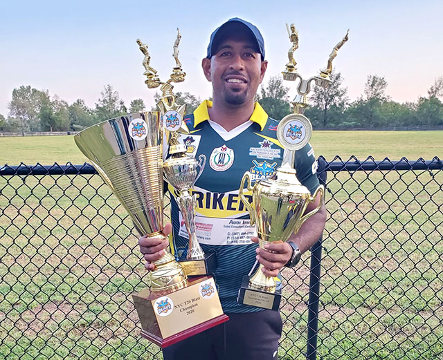 Gajanand Singh poses with trophies