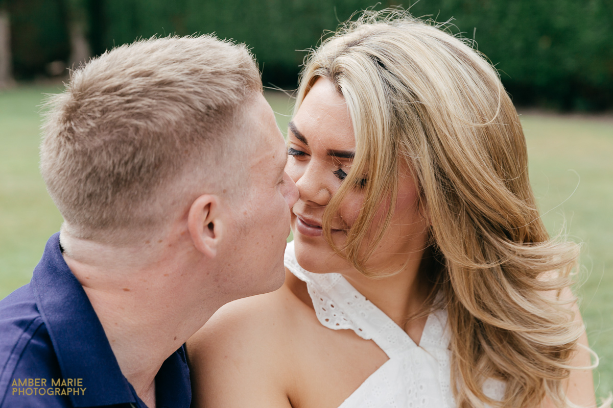 natural and romantic portrait of couple by cotswold engagement photographer