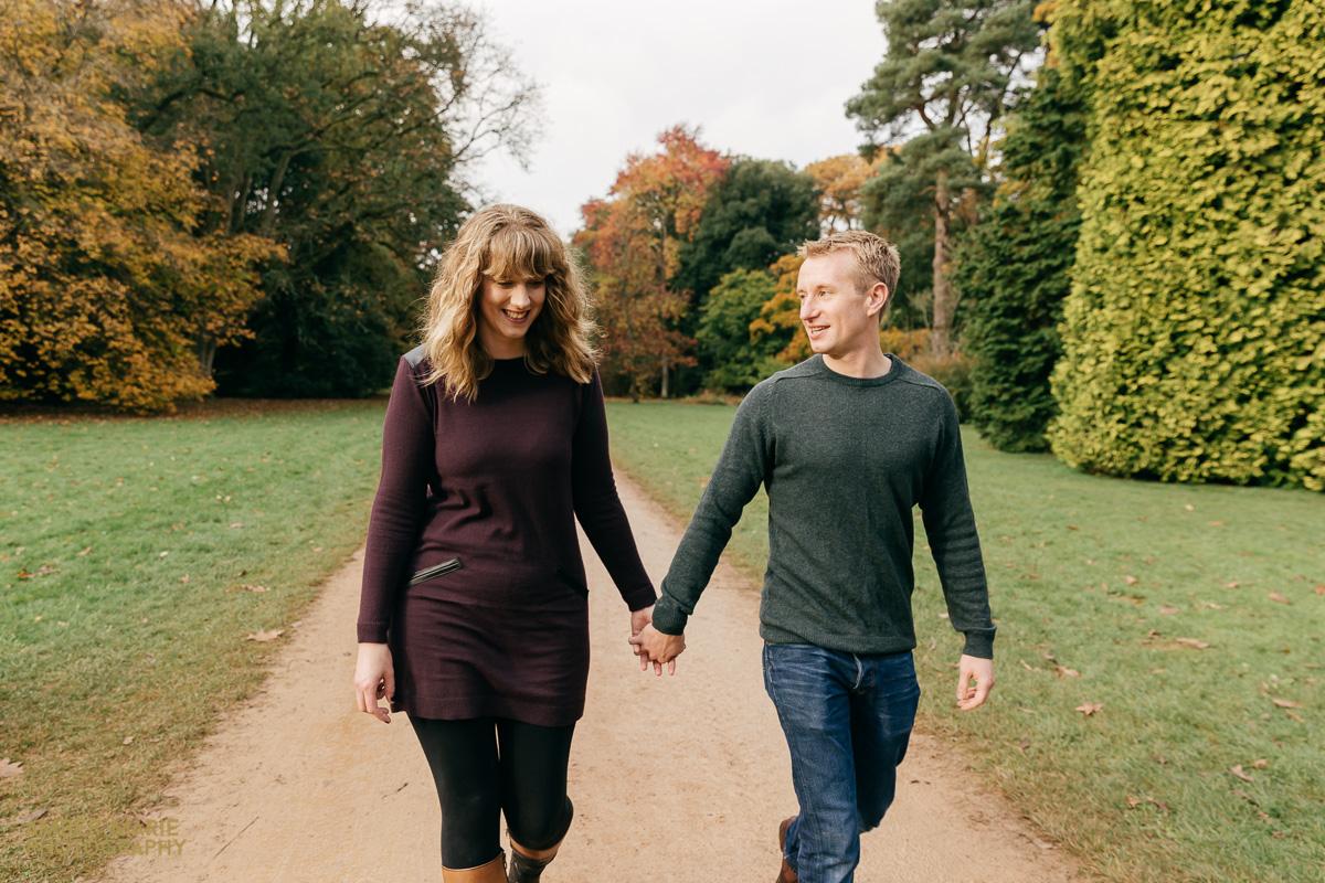 couple walking holding hands engagement photoshoot westonbirt arboretum