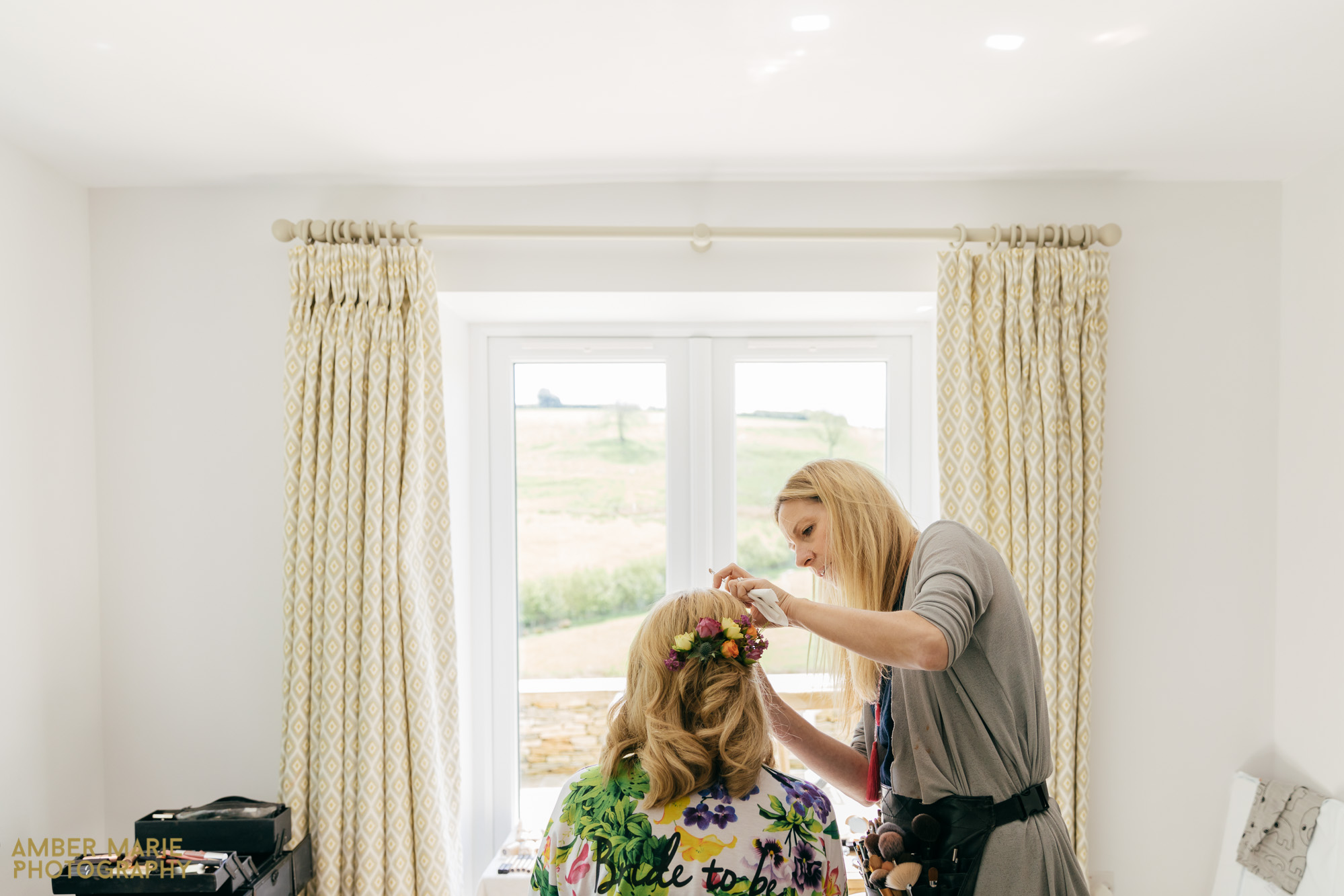 bride getting ready by Kingscote Barn Wedding Photographer