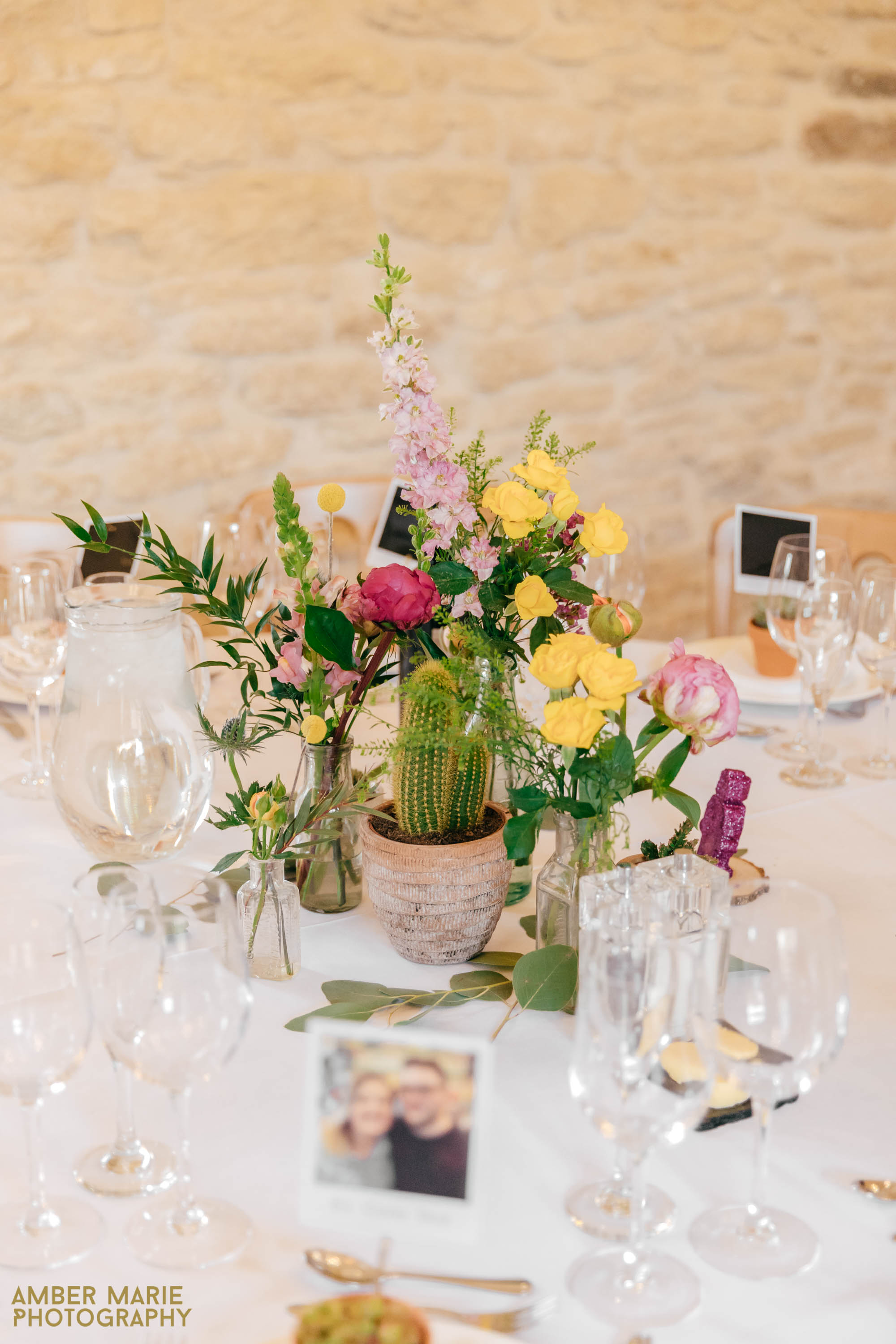 bright wedding flowers at kingscote barn