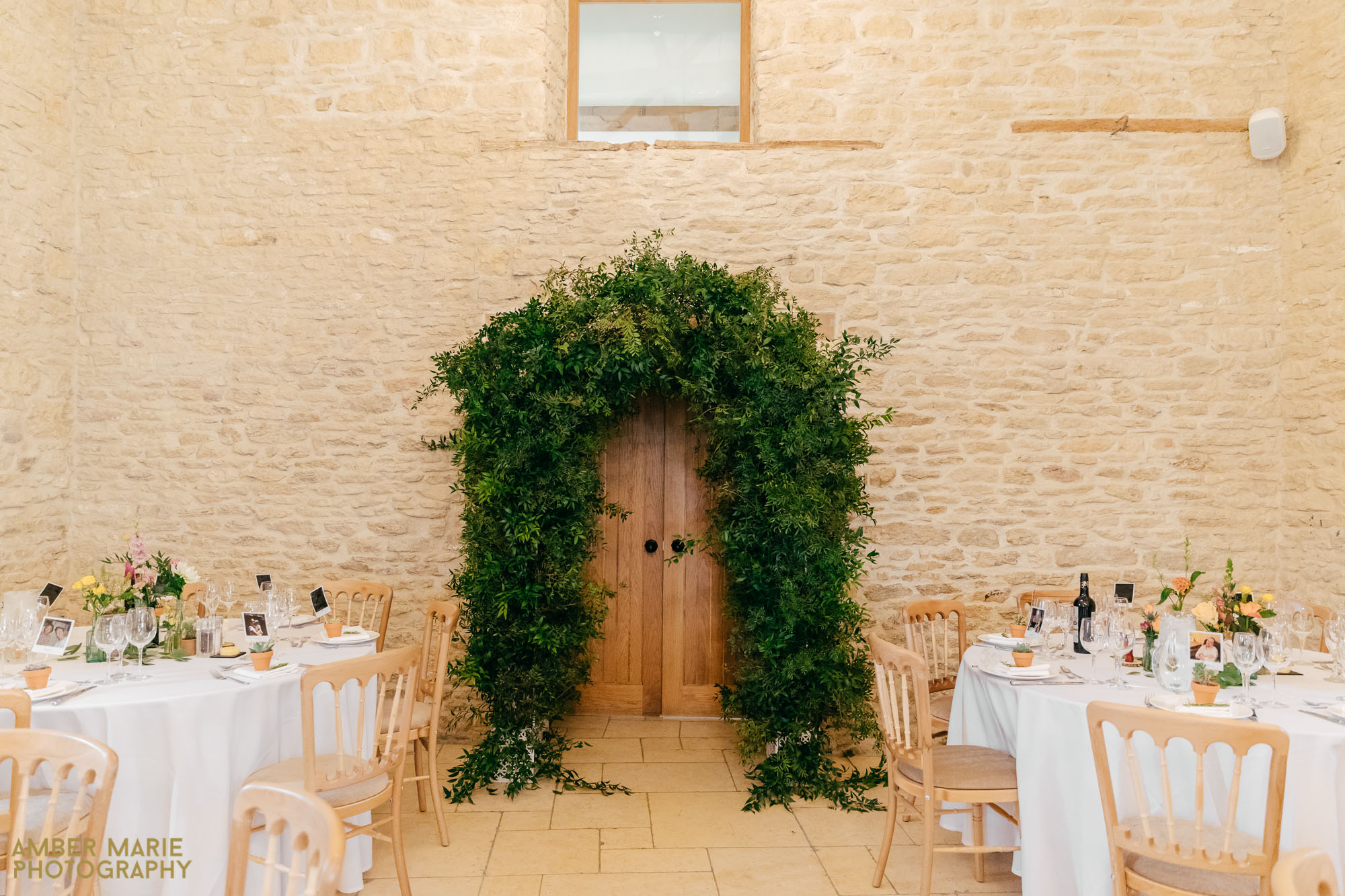 floral foliage arch at kingscote barn wedding