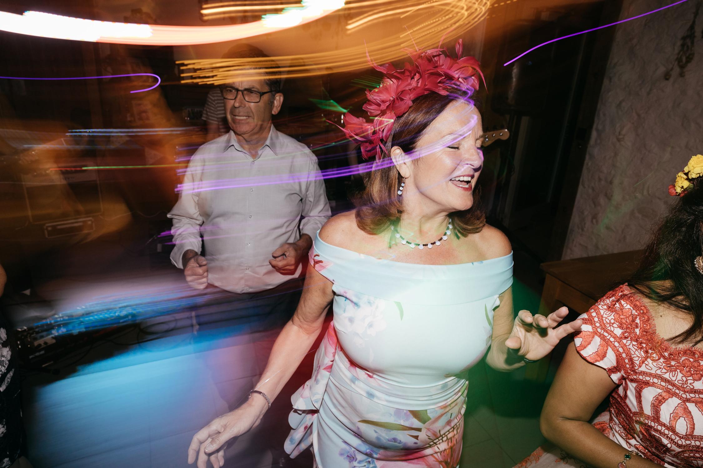 fun documentary wedding photos of guests dancing