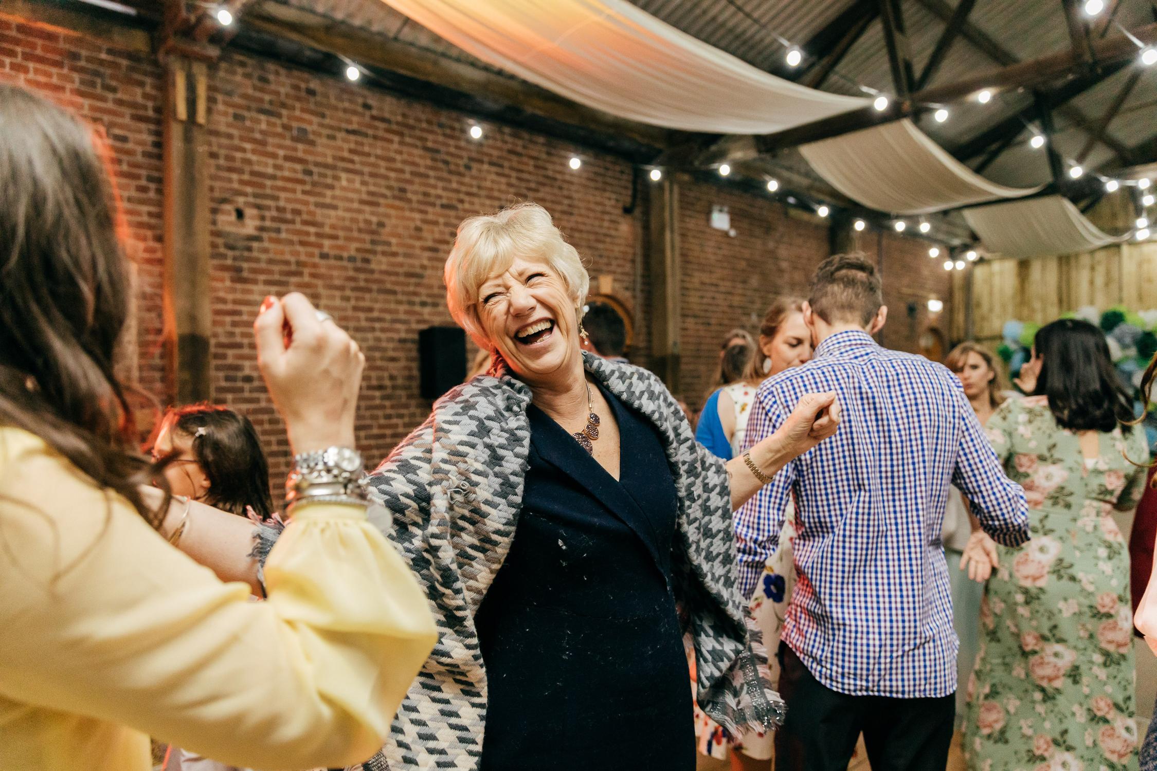 fun and joyful documentary wedding photography of guests dancing