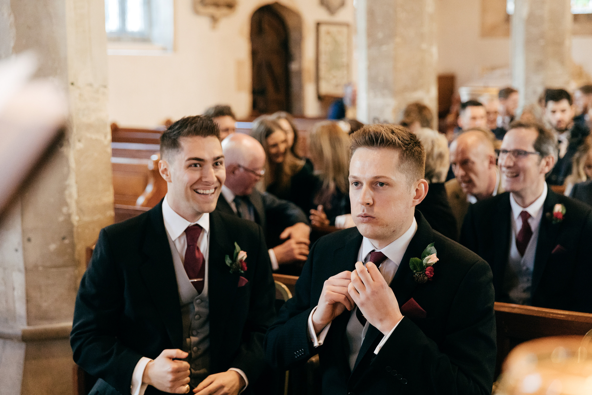 candid wedding photo of nervous groom