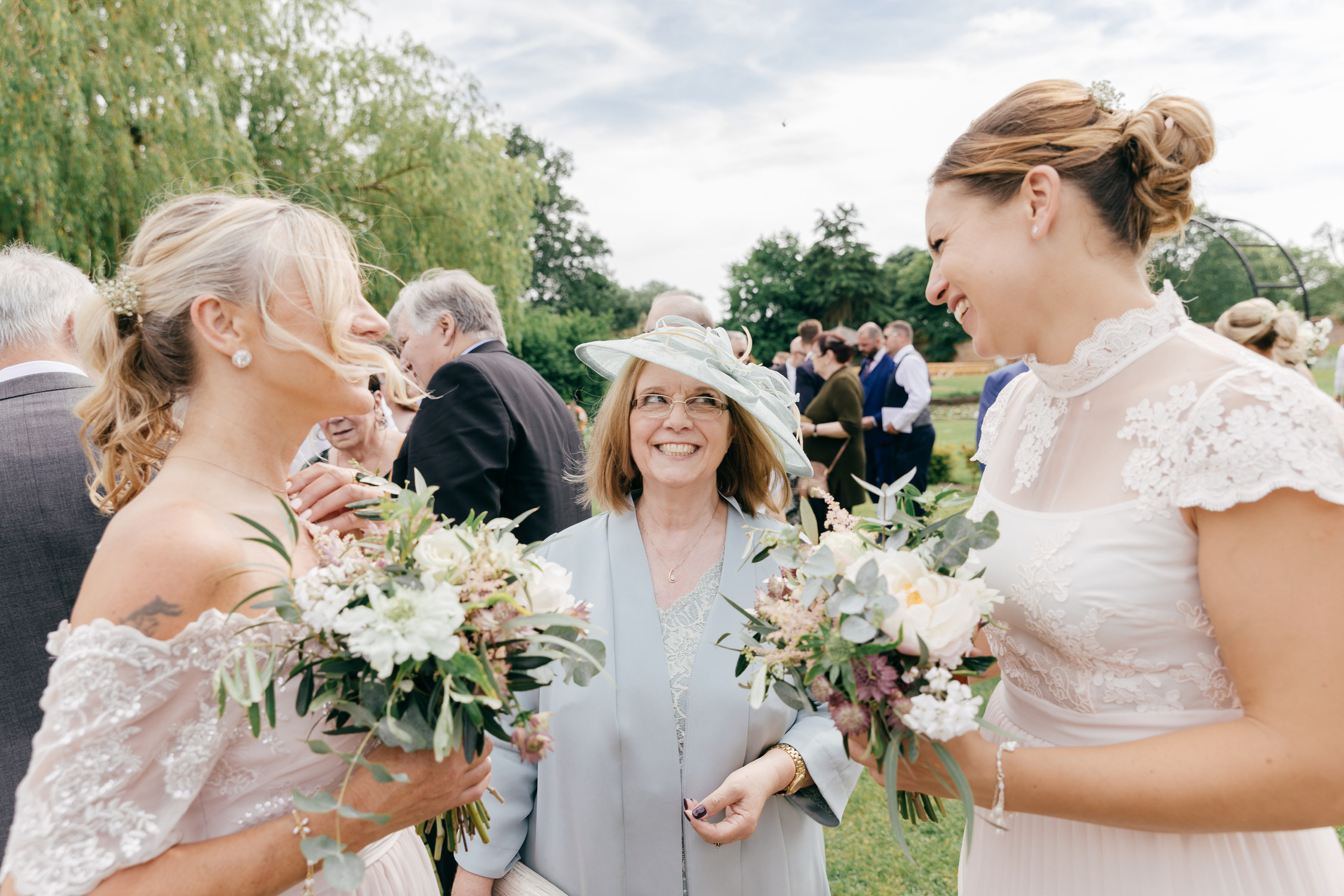candid portrait of wedding guest laughing