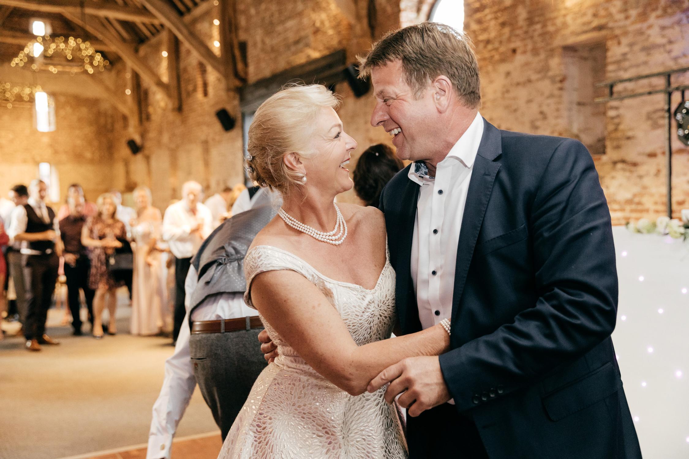 joyful wedding guests dancing