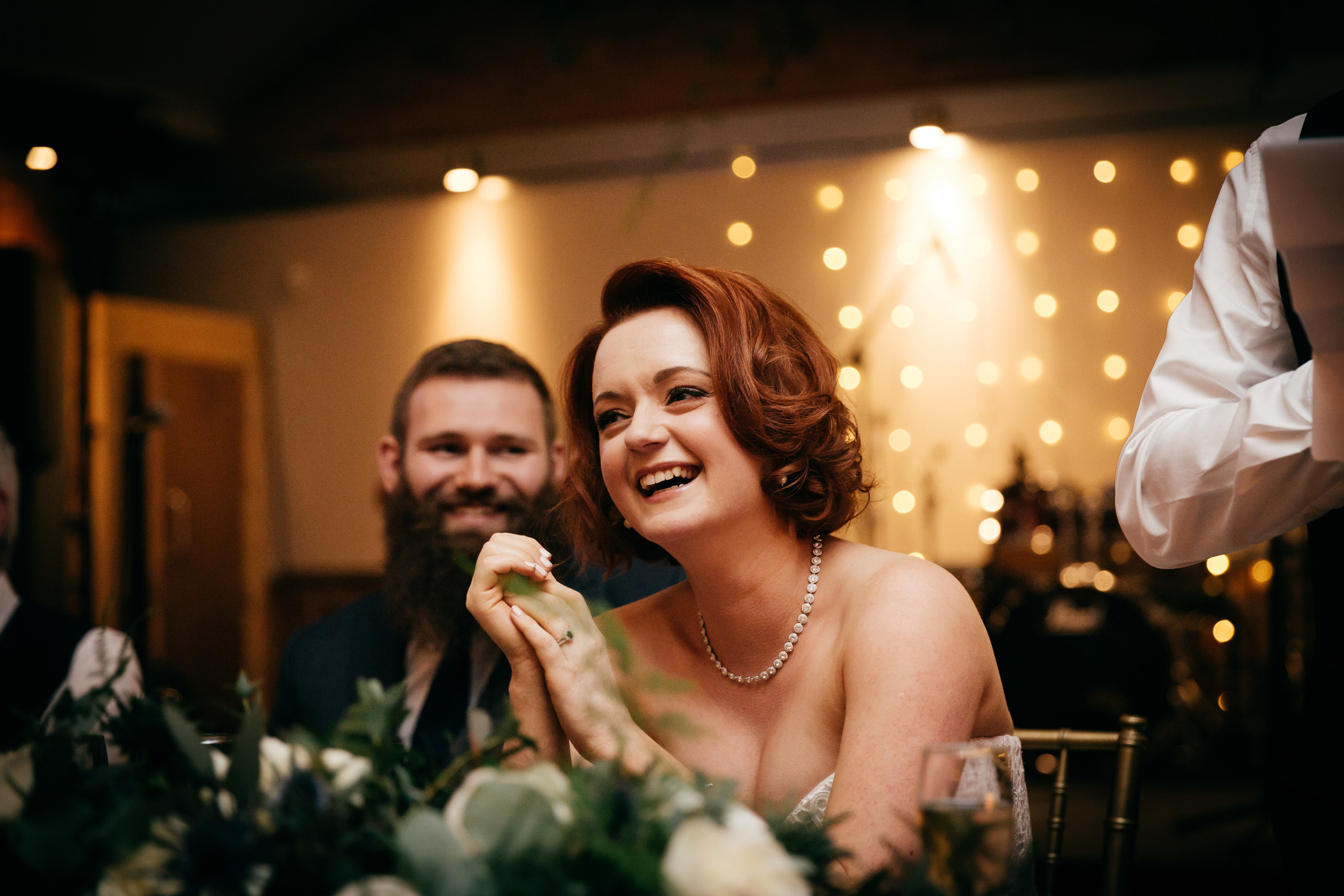 creative photo of bride laughing during speeches at new craven hall wedding