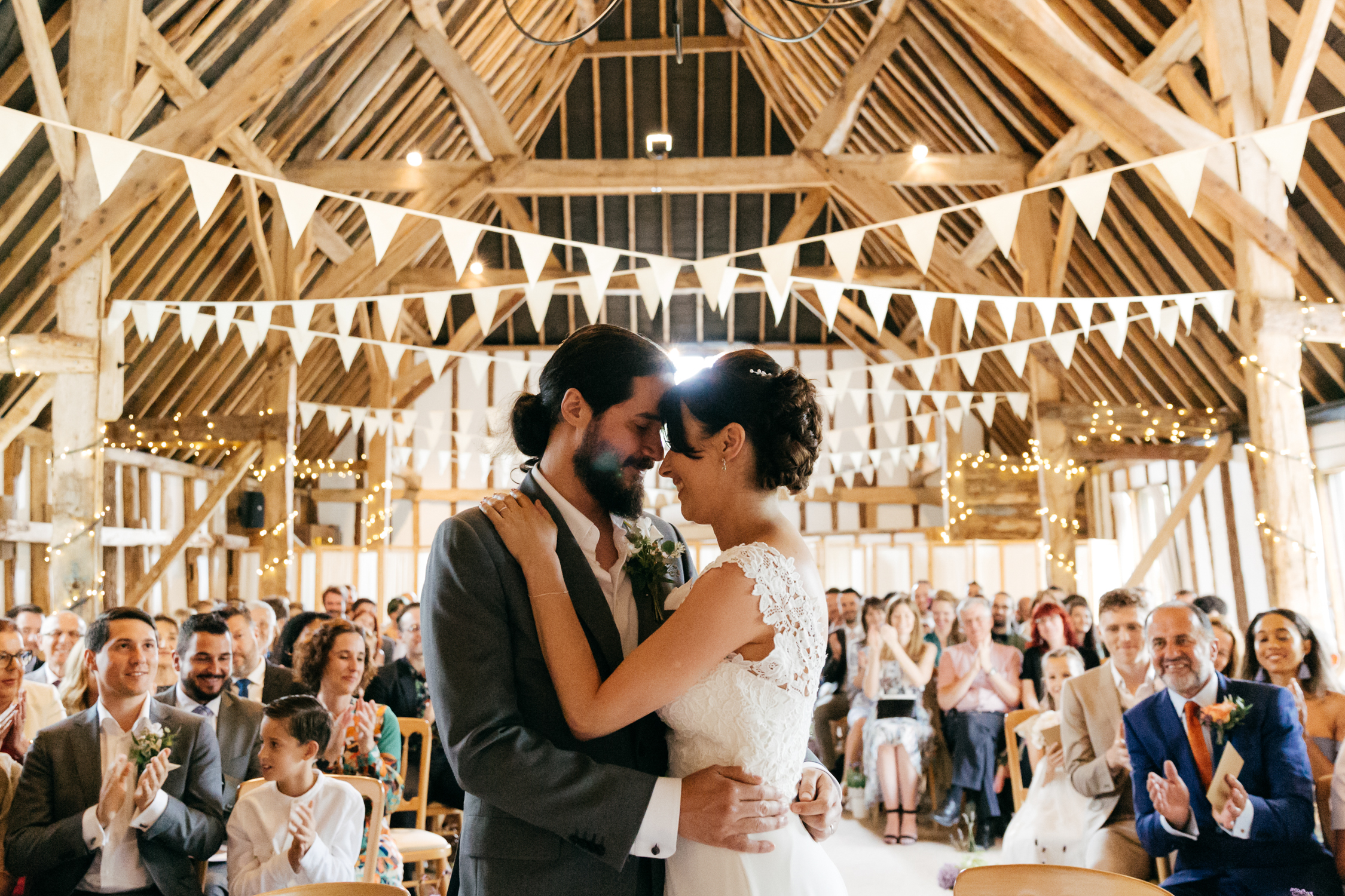candid wedding photo of wedding ceremony at clock barn